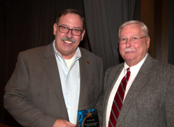 Allan Pavlick (left), vice president of Stertil ALM congratulated by Streator Mayor, Jimmy Lansford (right).