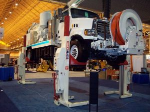 A Vac-Con truck sits atop mobile column lifts. Stertil-Koni and Vac-Con often partner at trade shows across the country.